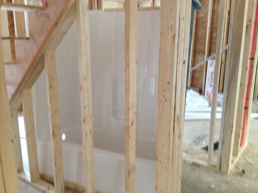 Our Guest Bathroom tub waiting for installation!